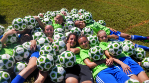 These girls are having a ball at camp ... All day - Every day !  Soccer Survival Camp