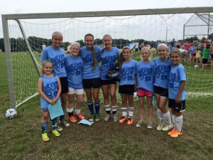 We are all in this together !  Great group of girls ... All playing some great soccer.